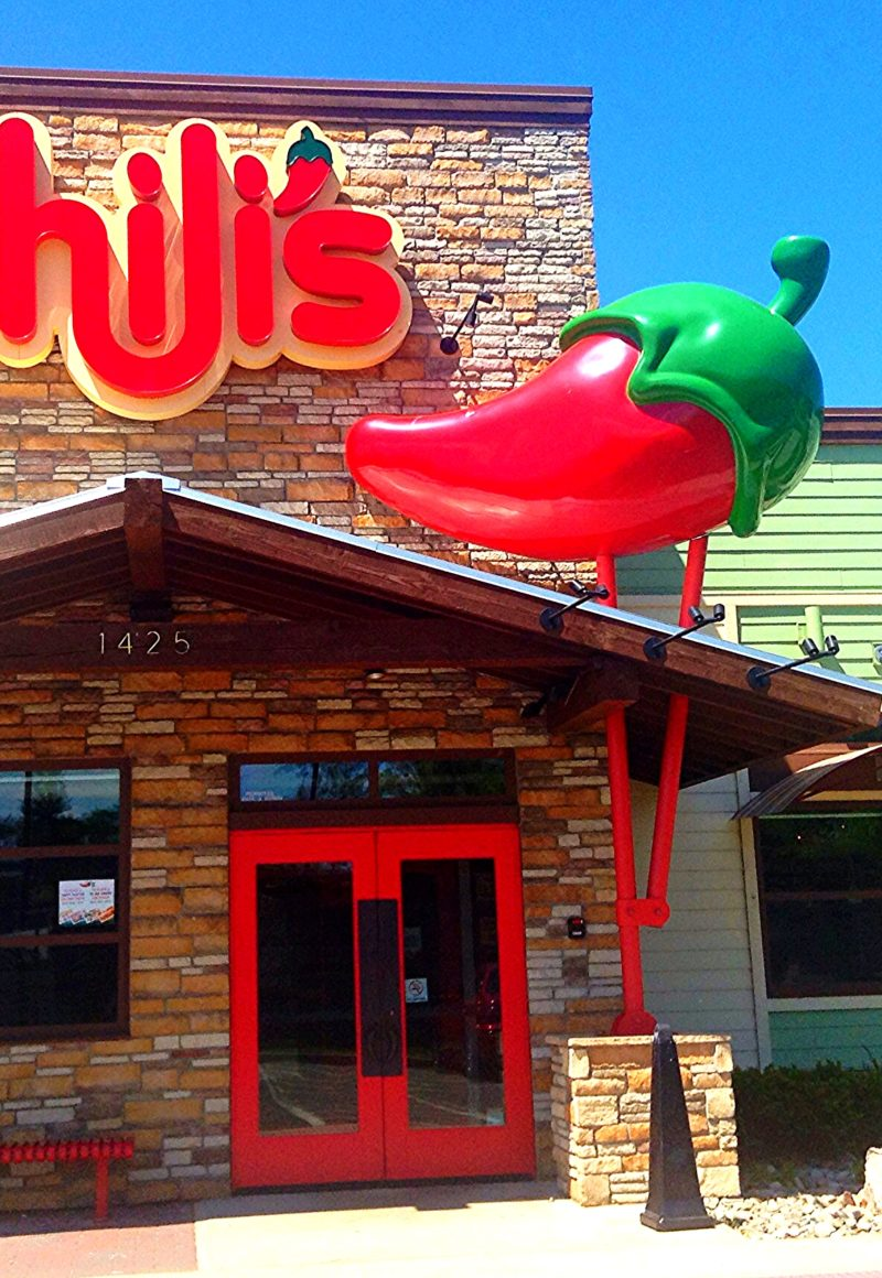 The exterior of a Chili's Grill & Bar. Its parent company's first quarter earnings fell short of expectations. - Mike Mozart / <a href='https://www.flickr.com/photos/jeepersmedia/14046147097/'>Flickr</a>