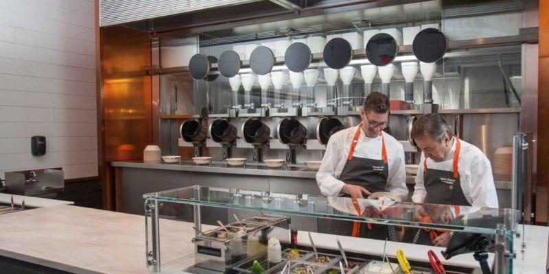 The Spyce restaurant in Boston, MA, with investor Daniel Boulud (R). / Spyce