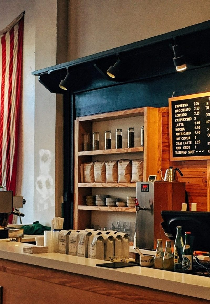 Press Coffe Bar in Dayton, Ohio. The stage is one of 29 that have a higher minimum wage than the federal standard. - Ian Baldwin / <a href='https://unsplash.com/photos/Dlj-SxxTlQ0'>Unsplash</a>